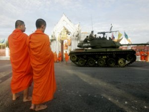 thai-monks-watch-as-soldiers-guard-an-area-near-crucial-government-buildings-bangkok-thailand